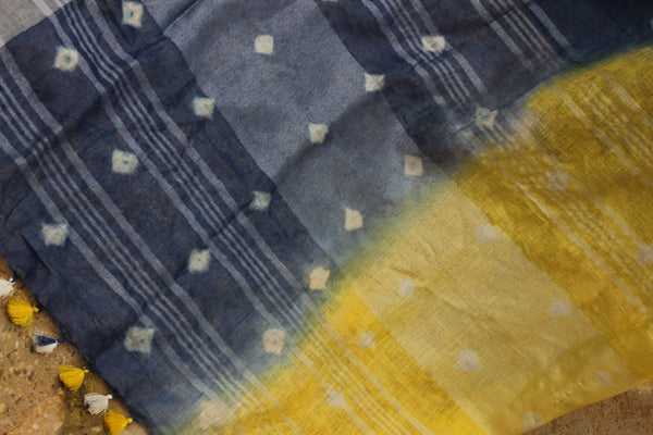 Yellow and Blue Shibori  tie and dye linen saree with contrast border and tasseled palla