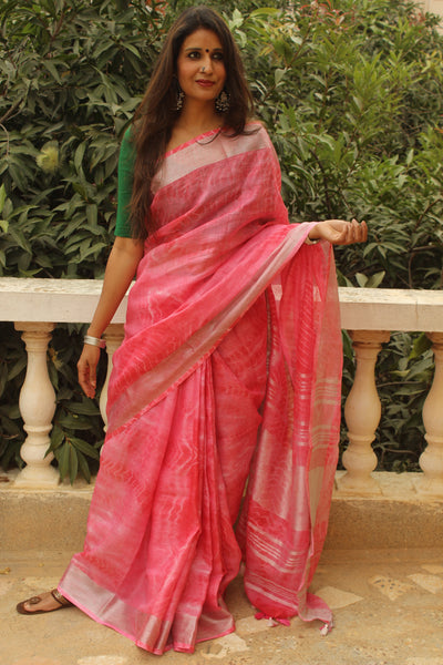 Pink Shibori tie and dye linen saree with contrast border and tasseled palla