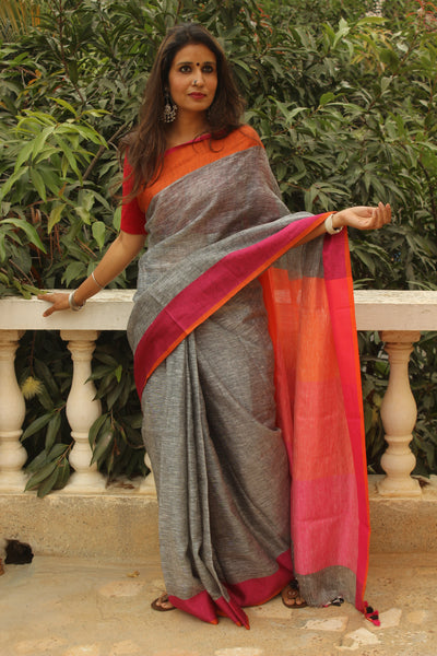 Grey linen saree with contrast border and tasseled palla