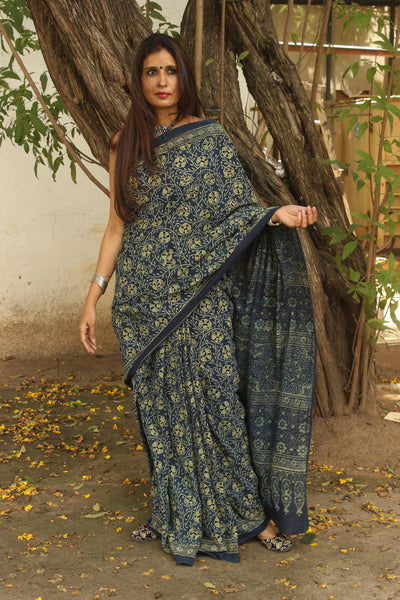 | Gul |- Indigo Handwoven vegetable dyed Ajrakh mul cotton saree .