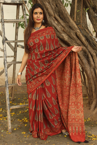| Farah |- Madder Handwoven vegetable dyed Ajrakh mul cotton saree .