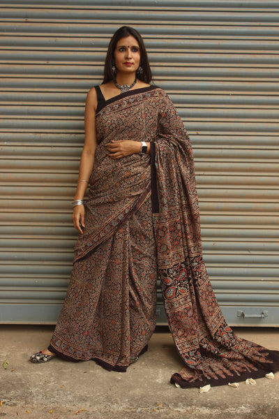 | Gulmohar |- Black Handwoven vegetable dyed Ajrakh mul cotton saree .
