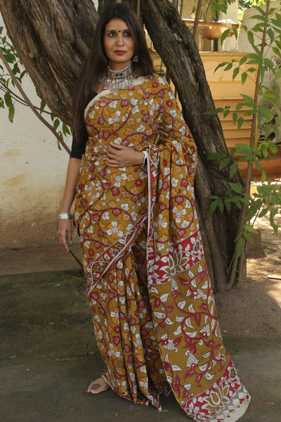 | Martini | Green Floral kalamkari cotton saree with border.