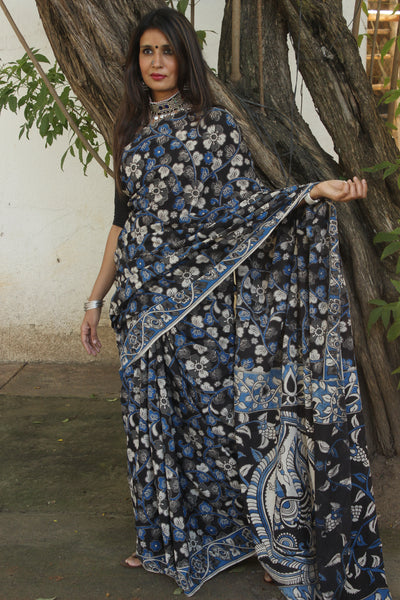 | Kalire | Black Floral kalamkari cotton saree with border.