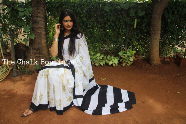 | In The Garden | White with Black border Printed mul mul cotton saree.