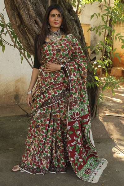 | Kavita | Off White kalamkari cotton saree with border.