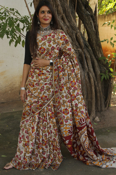 | Mahima | Off White Floral kalamkari cotton saree with border.