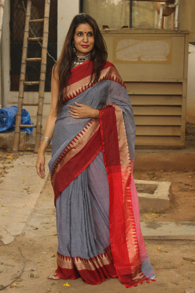 | ASHEN | - Grey with red temple border Cotton Saree.