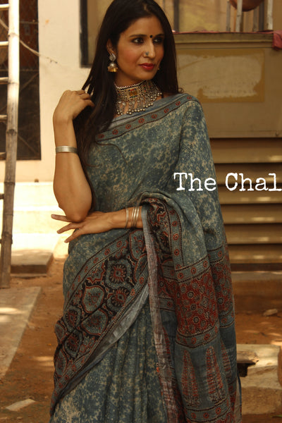 | Nakshatra | Indigo Handloom Ajrakh linen saree with zari border and tasseled pallu. KCH-LIN1-C12-The Chalk Boutique