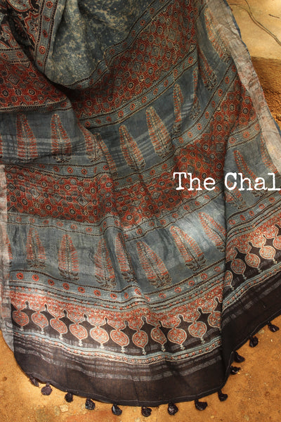 | Nakshatra | Indigo Handloom Ajrakh linen saree with zari border and tasseled pallu. KCH-LIN1-C12
