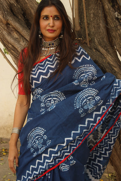 | Mask | Indigo hand block printed dabu saree with pompom border.