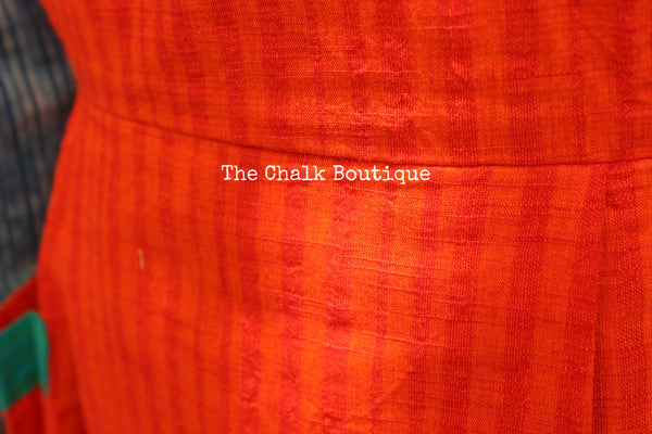 Orange Handloom Cotton Midi Dress with Kantha Embroidery and Bronze Charms. DRS0365