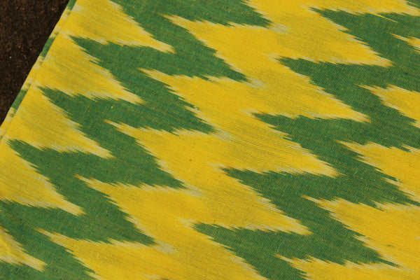 Green ikat fabric in handwoven cotton. TCB-IK3-P5