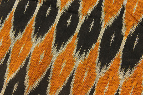 Black and mustard ikat fabric in handwoven cotton. TCB-IK4-P5