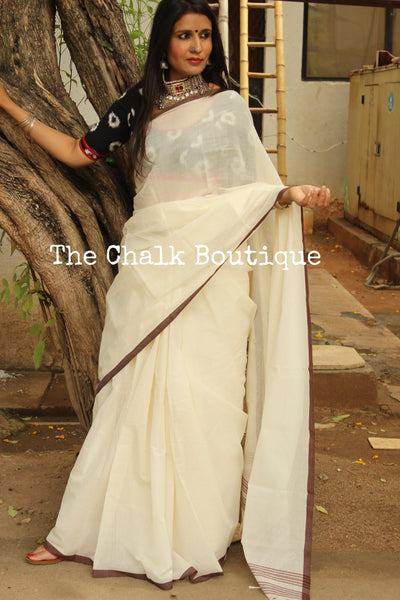 White 'handloom mark' handwoven begumpuri saree with thin brown contrast border. TCB-PI4-C2-BG