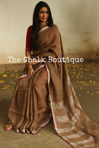 | Chocolate Tart | - Brown linen saree with contrast zari paar and tassels on the pallu. NF-LL1-C6