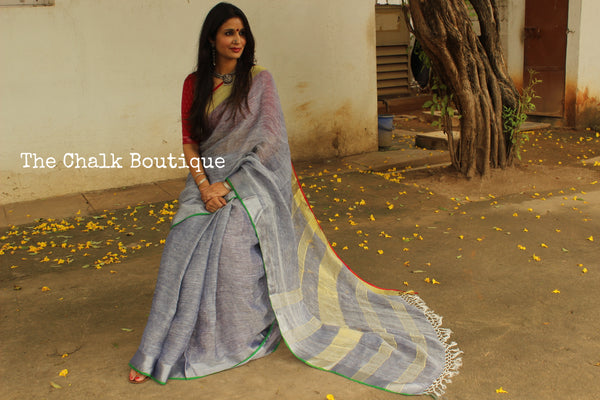 | Thunderstorm | - Steel Blue linen saree with contrast zari border and tasseled palla. NF-LL3-C6-The Chalk Boutique