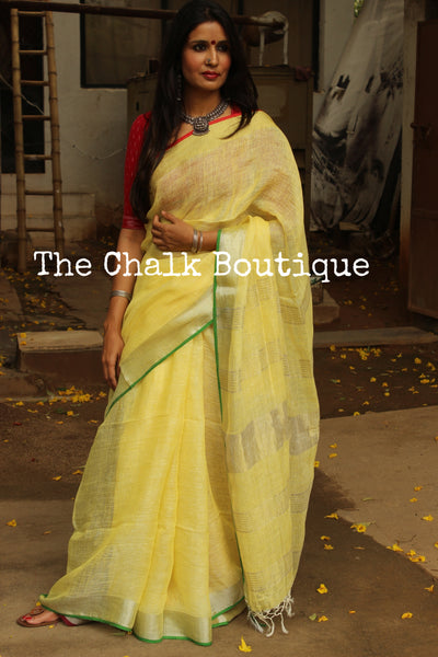 | Lemon Sorbet | - Lemon Yellow linen saree with contrast zari border and tasseled palla. NF-LL4-C6-The Chalk Boutique