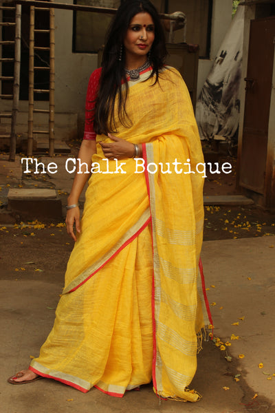 | Sunglow | - Festive Yellow linen saree with contrast zari border and tasseled palla. NF-LL5-C6