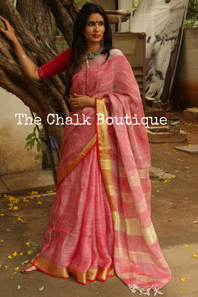 | Pink-Pong | - Festive Pink linen saree with contrast zari border and tasseled palla. NF-LL6-C6