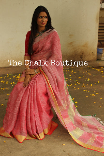 | Pink-Pong | - Festive Pink linen saree with contrast zari border and tasseled palla. NF-LL6-C6-The Chalk Boutique