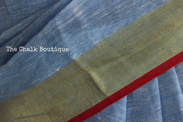 | Neela | - Festive Sky Blue linen saree with contrast zari border and tasseled palla.NF-LL8-C6