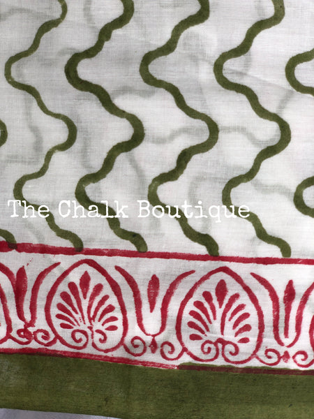 | Daisy | White and Green Hand block Printed mul mul cotton saree.