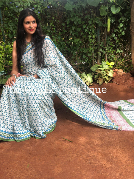 | Night Queen | White and Blue Hand Block Printed mul mul cotton saree.