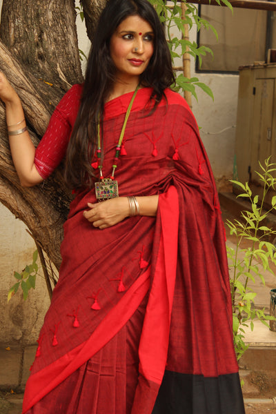| FEISTY | - Red and Black cotton Saree with thread tassels on border and pallu. TCB-POM6-CY1-The Chalk Boutique