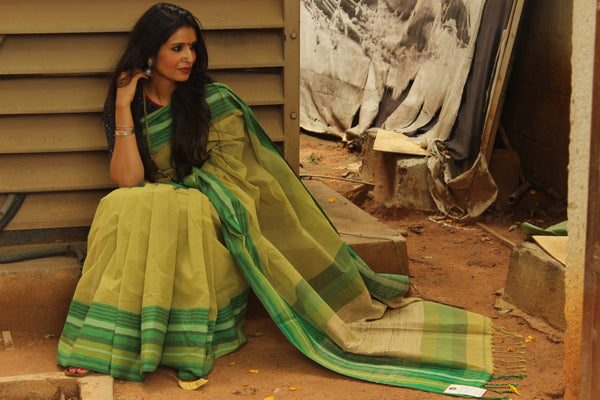 | Green Popsicle | Green Handloom Cotton saree with contrast striped yaar and gicha palla. TCB-AE6-BN