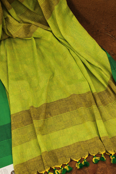 | Magic Wings | Green self woven handloom cotton saree with contrast paar and contrast pallu. TCB-COT3-CY