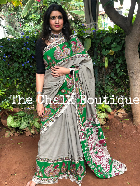 Grey with green broad border soft cotton kalamkari saree.