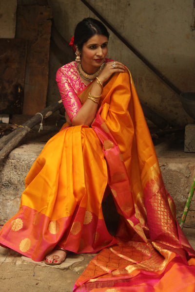 | HALDI-KUMKUM | Yellow Pure Kanjeevaram Soft Silk Saree with contrast border.