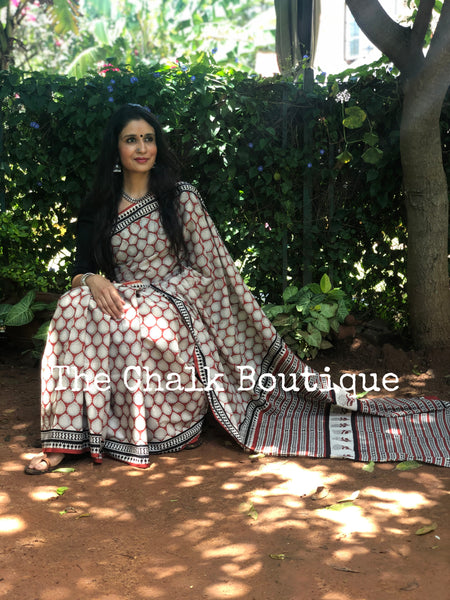 | Paan Patta | Red Traditional Dabu Handblock printed Cotton saree with off white bootas.