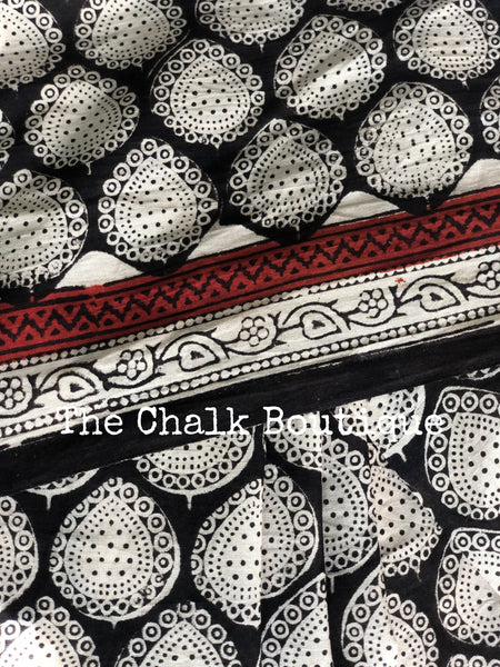 | Snowdrop | Black Traditional Dabu Handblock printed Cotton saree with off white bootas.