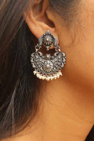 Intricate silver earrings with pearl drops . VA-5-DC