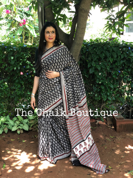 | Calendula | Black Traditional Dabu Handblock printed Cotton saree.