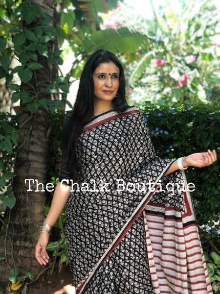 | Sunflower | Black Traditional Dabu Handblock printed Cotton saree.