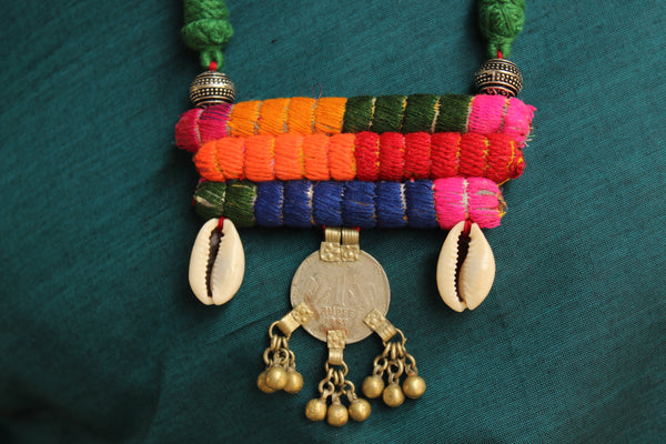 Adjustable double sided necklace with shell beads and coin. CC-CH3A-C2