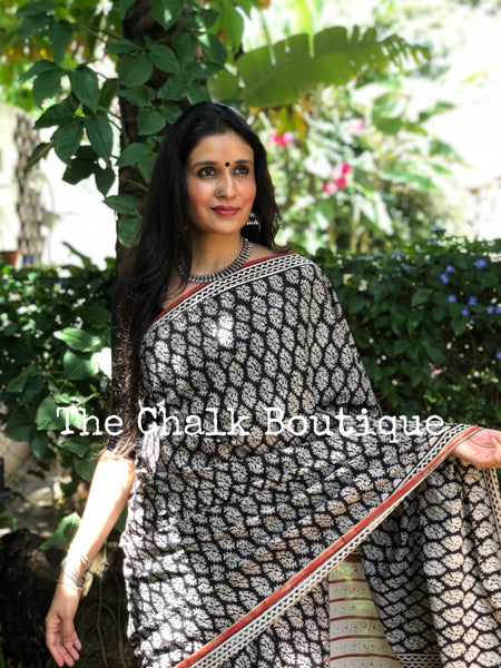 | Bluebell | Black Traditional Dabu Handblock printed Cotton saree.