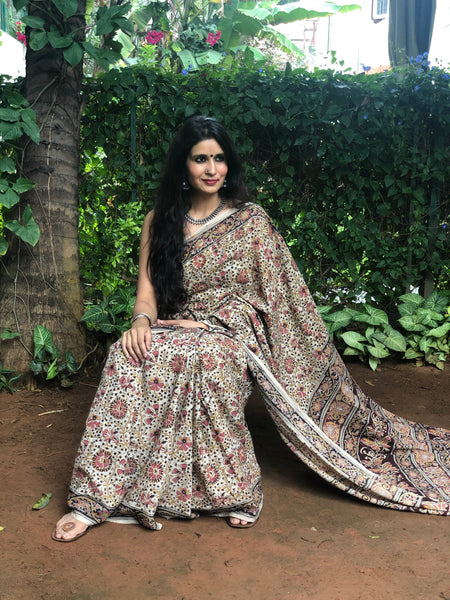 | Bagaan | Floral Overall kalamkari saree with thin border.