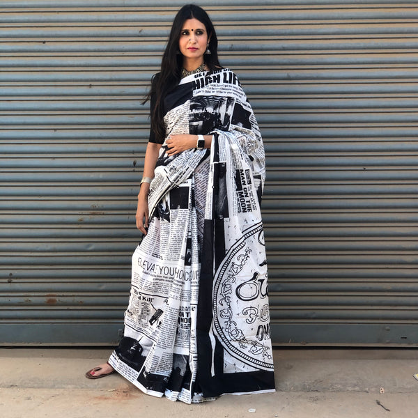 | Happy News |  Newspaper print mul cotton saree .