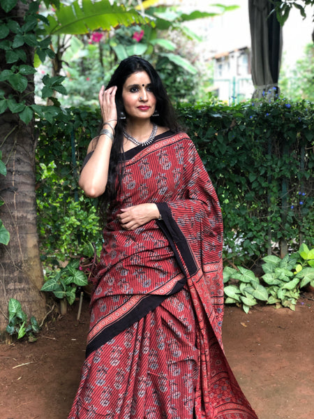 | Red Velvet | Red Handwoven vegetable dyed Ajrakh mul cotton saree.