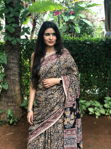 | Hana | Floral Overall kalamkari saree with thin border.