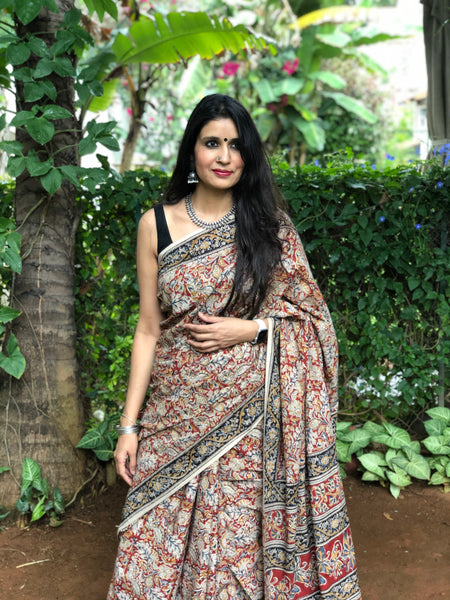 | Cherry Plum | Floral Overall kalamkari saree with thin border.