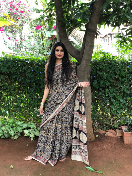 | Magic Whisper | Floral Overall kalamkari saree with thin border.