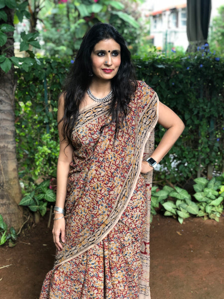 | Azalea | Floral Overall kalamkari saree with thin border.