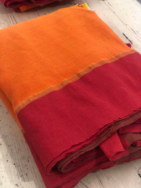 | Marmalade | - Orange cotton Saree with contrast pink border with thin zari.