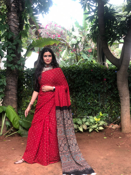 | Kumkum | Red with black vegetable dyed tie and dye ajrakh mul cotton saree .