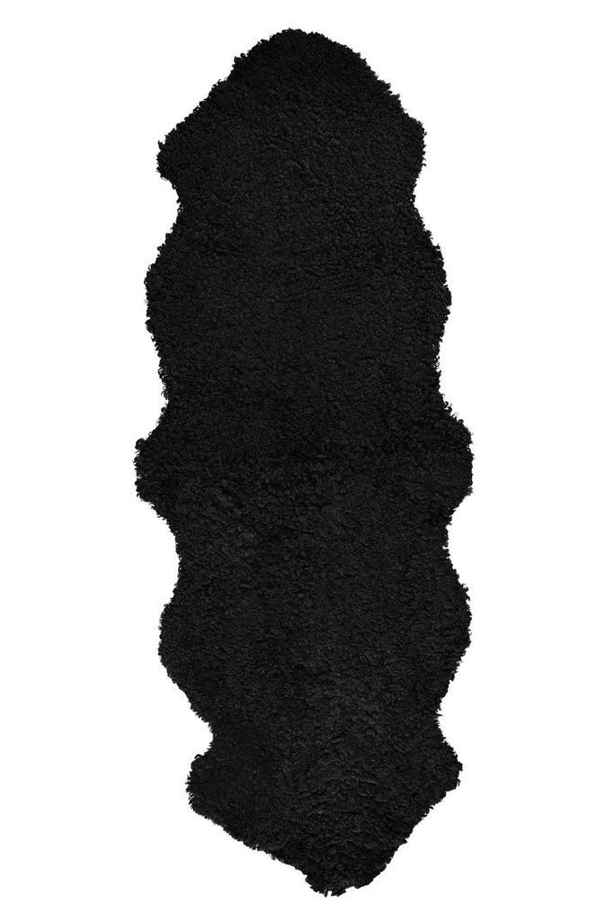 Black double short wool sheepskin rug